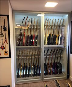 Click this image to show the full-size version. - Click this image to show the full-size version. Home Studio Musik, Music Studio Room, Guitar Storage, Guitar Rack, Ideas Armario, Home Music Rooms, Guitar Cabinet, Band Rooms, Basement Studio