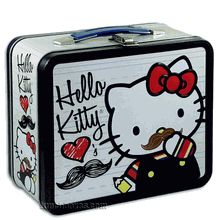 """Hello Kitty is shown on this metal lunch box with her hand-drawn moustache. The caption - looks like she has written it herself - says """"Hello Kitty Loves Moustache""""."""