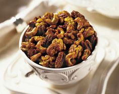 Sweet and Spicy Mixed Nuts- Make your own flavored nut mixes using Extra Virgin Olive Oil, Honey, Sugar, and your favorite nuts & spices