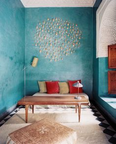 Moroccan Living Room: A sitting area in a blue-green guest room.