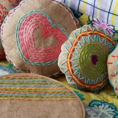 Burlap embroidered pillows.