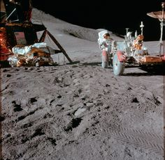 Jim Irwin Becomes 8th Man to Walk on the Moon (31 July 1971) Astronaut James B. Irwin, lunar module pilot, works at the Lunar Roving Vehicle (LRV) during the first Apollo 15 lunar surface extravehicular activity (EVA) at the Hadley-Apennine landing...