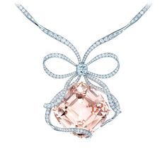 The Tiffany Anniversary Morganite necklace features a cushion-shaped 175.72-carat morganite surrounded by a diamond bow with a 2-carat Tiffany Novo diamond at the center.