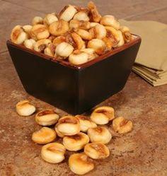 buy giant white corn kernels (also called maiz mote pelado), soak 18+ hours in water. Fry in pan 10 minutes or so, stirring often. Bam.