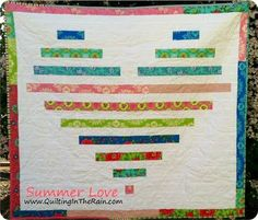 Summer Love Jelly Roll Quilt - Spread some love with this summer quilt pattern that uses colorful strip quilt piecing to make a gorgeous heart pattern. You can change the color scheme up and make this quilt pattern for a special occasion or holiday.