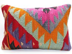 This beautiful pillow is made from a vintage Turkish Kilim rug. The front is naturally dyed wool, the back is a tan duck cotton, with a center zip.