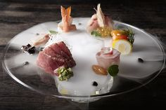 Omakase Sashimi without soy sauce (6 kinds of fish each one served with a different topping, and a dry ice cloud) by Yasuhiro Mineno, Yashin Ocean House and Yashin Sushi Bar, London