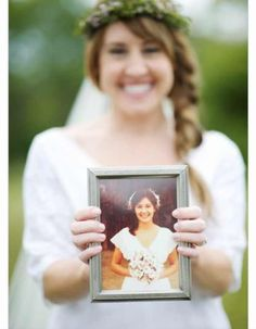 Holding a picture of your mother on her wedding day