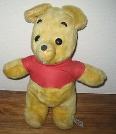 """Here we have a Vintage Disney Winnie The Pooh Bear. He is approx 11"""" tall. He is in good condition. He does have a small dirty spot on his shirt. I did not want to clean it for fear of damaging him. T"""