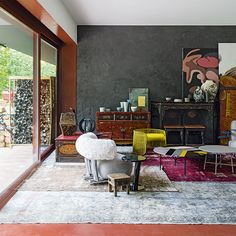 Halloween is the perfect opportunity to raid your wardrobe or dressing-up box, giving those long-lost treasures a new lease of life. This room is the decorating equivalent of said treasure chest: the textured black wall creates depth, and grounds  the many layers of carefully chosen pieces. Meanwhile, terracotta tones found in the intricate furniture and artworks are pulled through the scheme and framed by the floor and painted window recess. Not a trick, this is a pure treat.