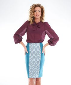Turquoise pencil skirt with decorative pattern.The skirt is ideal for office outfits but can be easily worn in a casual outfit.  Hidden zipper closure on back.  Lined.  Length 56...