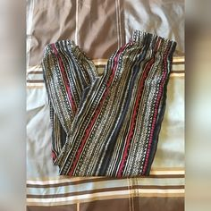 Tribal satin feel loose joggers Like new condition Wore 2-3 times Elastic belt  Elastic cuff around ankles Pants Track Pants & Joggers