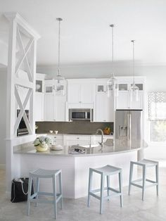 Curved kitchen counter in a coastal style kitchen