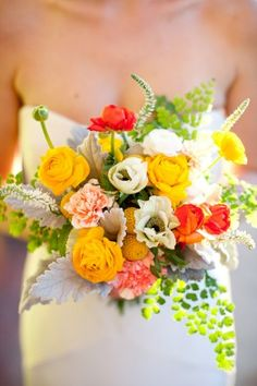 Maidenhair fern and ranunculus are showstoppers in this bright bouquet!