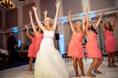 """I'm pretty sure someone asked these ladies """"Is (once like a spark) the best wedding photography company ever?"""" Clearly, one hand wasn't enough ;) Seriously, though, we have so much fun when our couples do and loved seeing this bridal party bust a move!  ::Laura + Patrick's sophisticated summer wedding in Washington, DC:: #bridalparty #choreographed #dancingparty #throwyourhandsintheair #demetriosbridal #demetrios"""