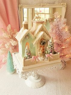 This limited edition house has an all over soft metallic glitter in vintage silver and pale gold. There are so many fine details - a 2nd story balcony, ornate gingerbread trim and a picket fence overflowing with snow touched pink roses. Youll find more pink accents on the pink sugar