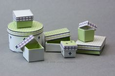 Make lined, openable miniature printable shop boxes in several color schemes for dollhouses or other scale miniature displays.