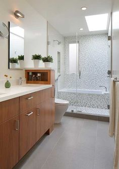 A walk in shower with a tub built into the enclosure. See how to love your bathroom again with these intelligent but inexpensive walk in shower tile design ideas. Bathroom Tile Designs, Bathroom Layout, Bathroom Interior, Modern Bathroom, Small Bathrooms, Bathroom Storage, Bathroom Ideas, Bathtub Ideas, Shower Designs