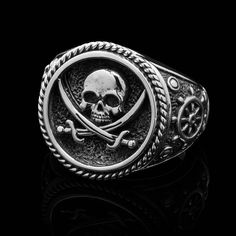 """In the pirates began referring to their flags — usually consisting of skull-and-crossbones on a black backdrop — as the """"Jolly Roger."""" The pirate who. Pirate Jewelry, Golden Age Of Piracy, Black Hills Gold Jewelry, Jolly Roger, Skull And Crossbones, Rings For Men, Bling, Clocks, Dragons"""