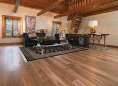 A cosy, rustic living room floor by Weston Flooring  #cozy #rustic #livingroom #flooring #hardwood