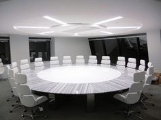 The Round Table: Lineac Marble and white corrian infield for the creme de al creme boardrooms.