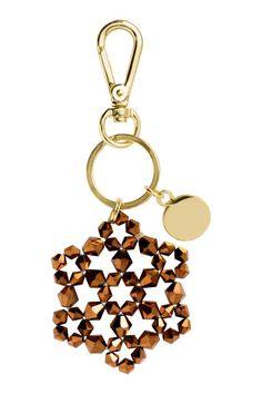 Portachiavi: Portachiavi in metallo con moschettone e pendente con pietre di plastica sfaccettate. Diametro 6 cm, lunghezza circa 13 cm.