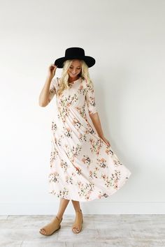 Light Pink Maxi Dress Carnation + Pink Floral Bouquet Print 3/4 Sleeve Gathered Waist + Hip Pockets Flowing Fit Also Available in Ivory