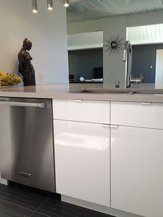 Kitchen inspiration light and glossy cabinets add an for Atrium white kitchen cabinets