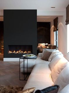Low fireplace with black surround to ceiling
