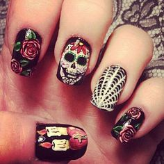 Day of the Dead...what popped out to me first were the candles. I think that is my favorite nail.