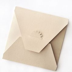 DIY Flower Tabbed Envelopes - A step-by-step tutorial on how to create these adorable flower-tabbed envelopes. Download included. Click through to make your own!
