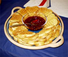 Norwegian waffles have cardamom in them and are served with jam, sour cream and brown cheese. Not sure about the brown cheese but this looks yummy!