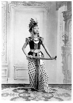 Indonesia ~ Central Java | Studio portrait of a court dancer; possibly the court of the Sultan of Yogyakara or from Susuhunan of Solo (Surakarta) | ca. 1910 - 1930, photographer unknown