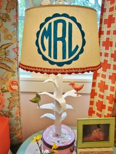 The monogram on the lampshade is actually made of craft store felt and some spray adhesive!