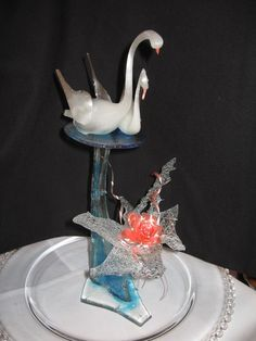 Pulled Isomalt Swans - Blown isomalt swans with bubble sugar and a rose.