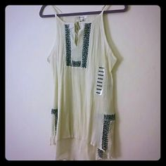 """Peasant- like Tank Top Cute gauzy tank top with keyhole tie at the neck. High low hem with side slits. Bought at Nordstrom Rack this summer.   27.5"""" in the front 30"""" in the back laffaire Tops Tank Tops"""