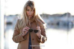 camel coat and firespit sunglasses
