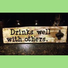"""Drinks Well With Others"" - This is one of my favorites.  It's sold, but I'd be happy to make a special sign for you!"