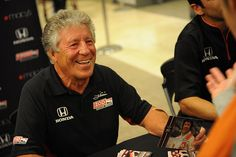 1969 Indy 500 Champion Mario Andretti meets fans at the IZOD autograph session at Macy's Union Square.