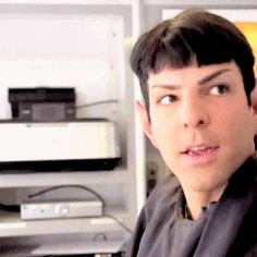 Gif of Zachary Quinto as a scruffed up inquisitive spock