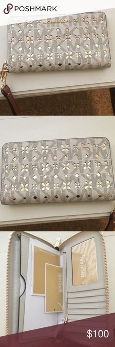 NWT MK wallet ✨ Brand new Michael Kors wallet. Brown leather strap, white wallet with gold accents. Very shiney and cute, with a lot of room for your money cards and change, make an offer! ✨ Michael Kors Bags Wallets