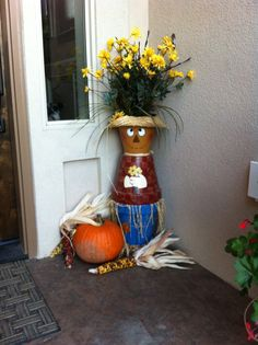 Welcome Fall with a scarecrow made of pots.  Saucer for bottom, two matching size for body and a smaller one for the head. Add some raffia and a straw hat. My favorite fall decoration.