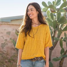 "JANESSA PULLOVER -- Our cheery, comfy V-neck cotton-blend pullover features subtle chevron stitch detailing with a gentle V-neckline, elbow-length sleeves and rolled hem and sleeves. Cotton/nylon/silk. Hand wash. Imported. Exclusive. Sizes XS (2), S (4 to 6), M (8 to 10), L (12 to 14), XL (16). Approx. 22""L."