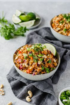 bowl of thai quinoa salad on a linen with cashews