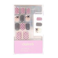<P>Parisian style comes to your manicure with these pretty faux nails. Includes pink with black polka dots, black and white stripes plus French manicure with black bow designs.</P><UL><LI>Includes 24 nails and nail glue</LI></UL>