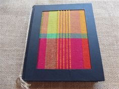 "This colorful book is extra special! It has a colorful handloomed fabric cover and 91 pages of handmade paper. It is 5 1/2"" x 6 1/2"" making a special notebook, sketchbook, or journal.  In addition, it is a Fair Trade product, made from 100% recycled paper and made with handloomed and dyed fabric. The colors and look are inspired by the colorful  people, land and seascapes of Sri Lanka. http://www.athousandbutterflies.com/Sri-Lankan-Handloom-Notebook-p/tbt-s39hbm.htm $14.95"