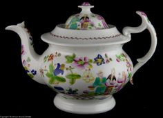 Dating to 1820 this large Hilditch teapot is decorated with the chinoiserie pattern Boy offering flowers