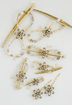 Open Flower with sparkling stonesets and accents of aurora borealis faceted beads all in beautiful gold plate.