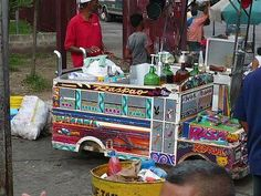 """Only in Panama-very original. Street cart selling """"Raspados"""" which are Snow Cones topped with flavored syrups and condensed milk. They have several blocks of ice and have an awl-type of scraper that they can fit a paper cone cup where the shaved ice collects. They shave the ice for you right in front of you."""