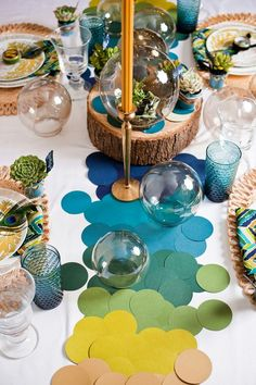 Colored dots cut out from paint chips as table decorations